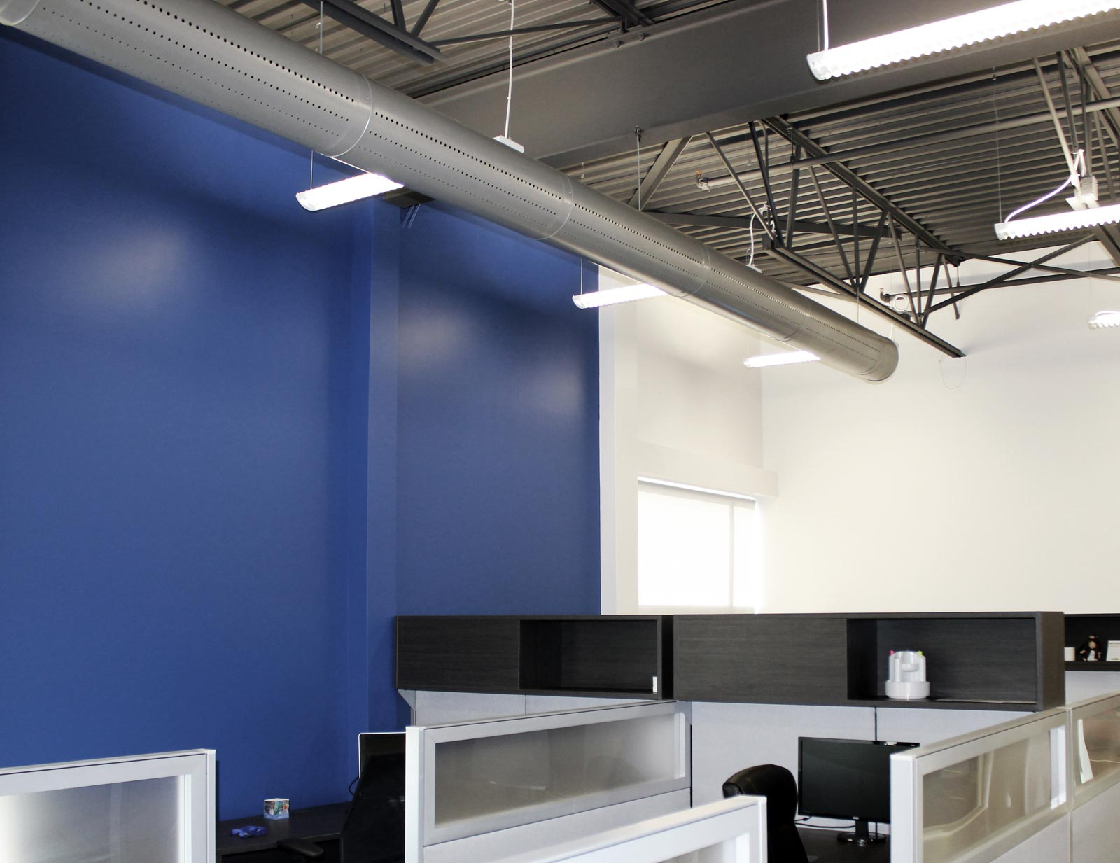 Photo of Prihoda rigid duct installed, with background of royal blue wall