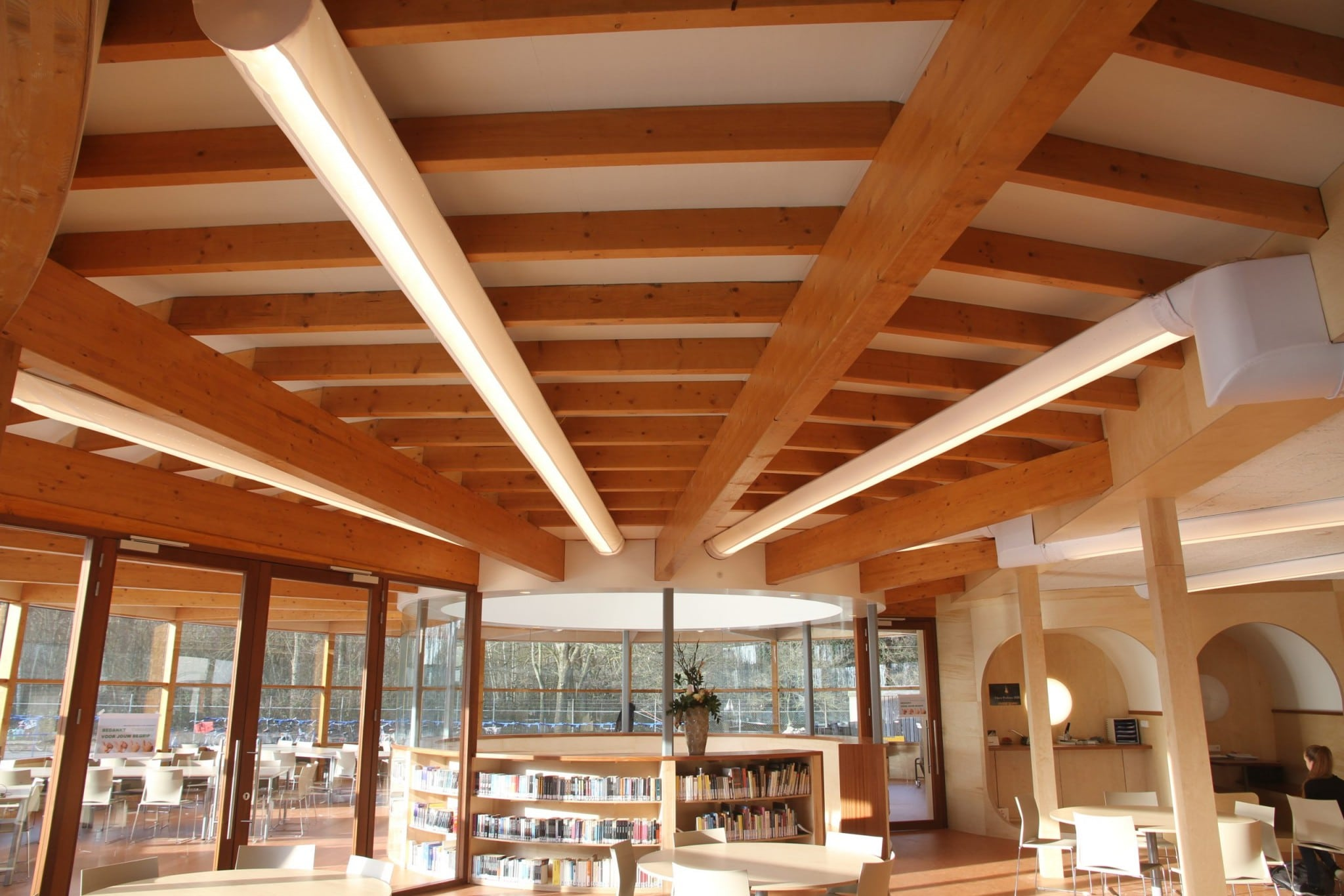 Wide-angle photo of Prihoda fabric ducting and exposed beam ceiling at Bornego